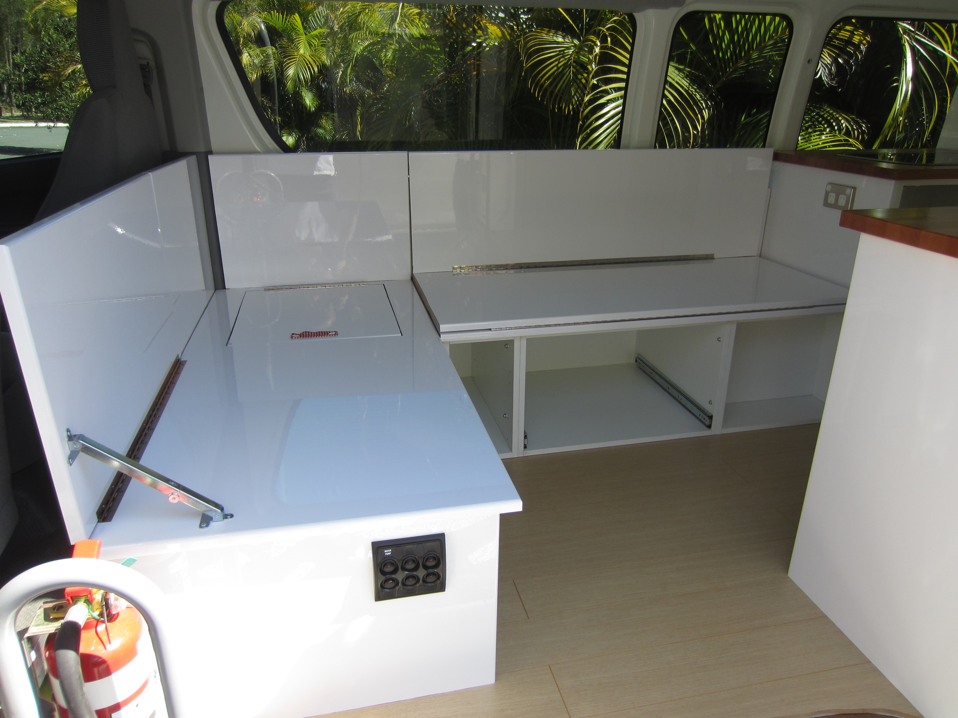 Campervan seating bed conversion the campervan converts for Campervan kitchen ideas